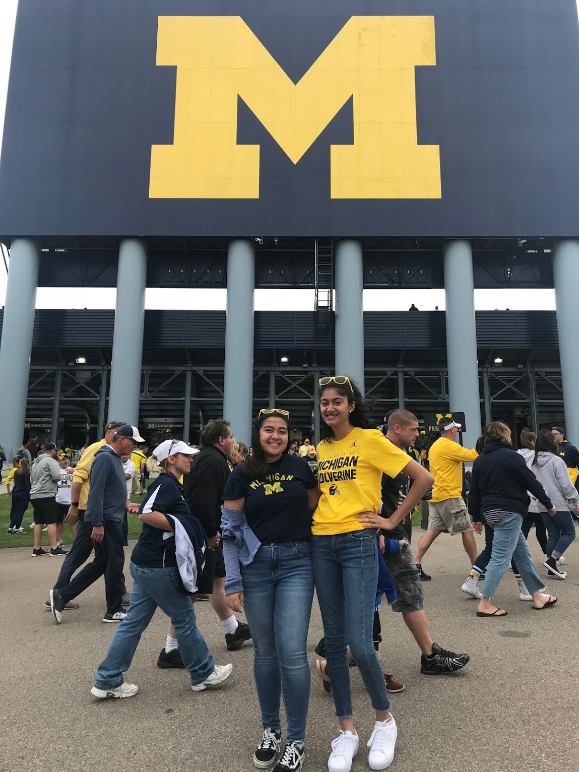 two girls in front of U-M football stadium