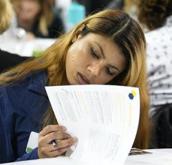 A student reviewing papers while in class