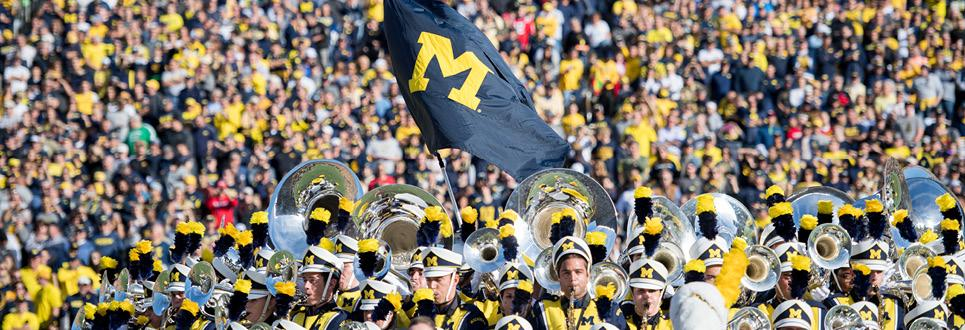 The Michigan Marching Band plays on the field