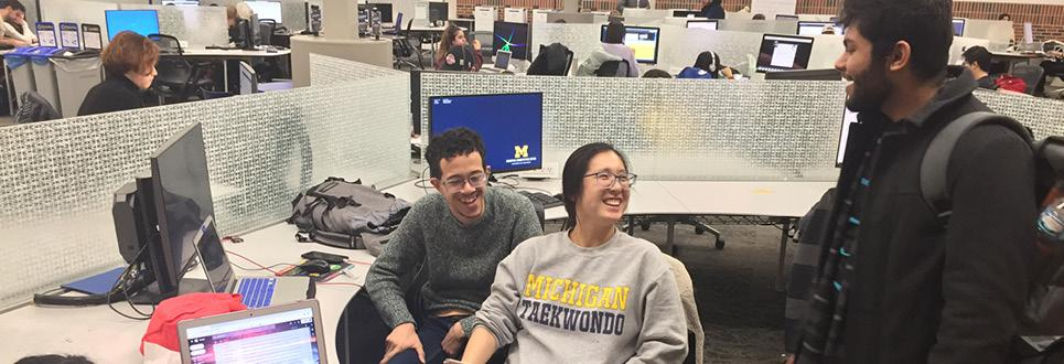 Students converse in the Fish Bowl computer lab
